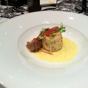 Twice cooked caramelised onion and spinach soufflé, eggplant relish, saffron sauce.